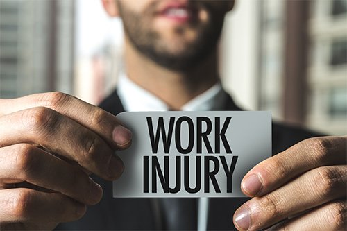 Lawyer Holding Work Injury Card